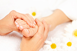 A foot massage at your home in london.